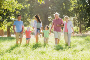 multi-generation family enjoying a walk in a beautiful countryside