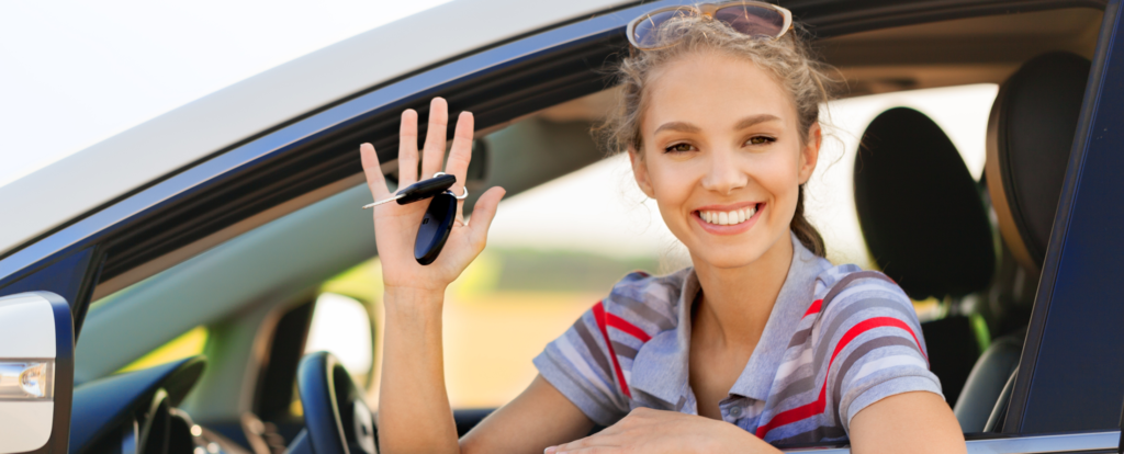 car truck loan special image of happy woman in car